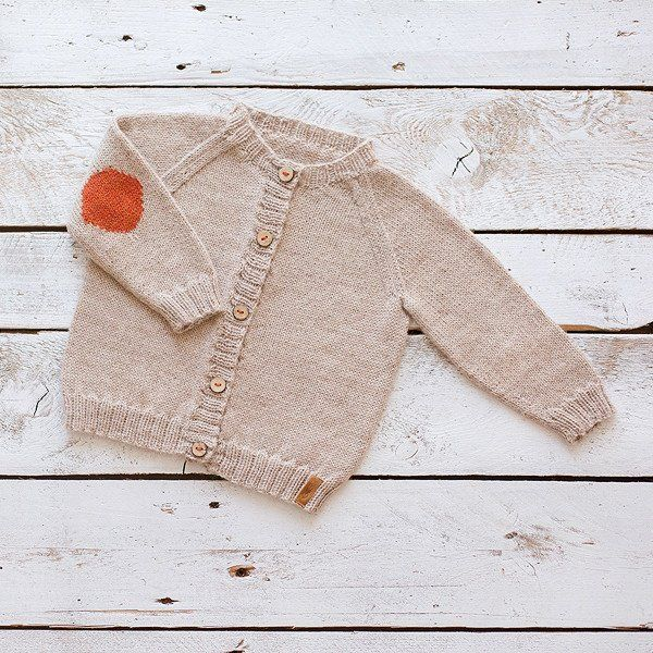 Natural un-dyed camel-colored alpaca wool with brick red elbow patches is super comfy and adorably cute. The ultra soft alpaca knit sweater has no side seams to chafe or bulk and flows easily with bod