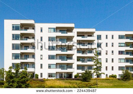 Modern apartment building on a sunny summer day in Hellerup, a suburb of Copenhagen, Denmark. - stock photo