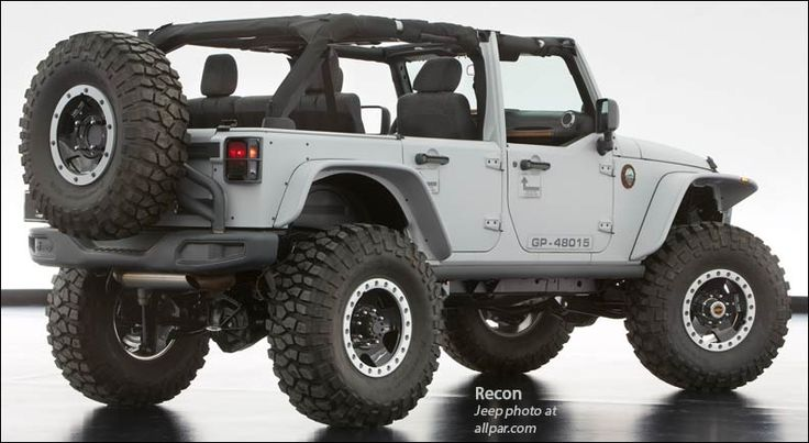 """The Jeep Wrangler Mopar Recon front and rear half-door and window kits, front and rear off-road modified """"Stinger"""" bumpers, Warn winch, high-clearance flat fenders, rock rails, Jeep Wrangler Rubicon 10th Anniversary hood, prototype LED headlamps, a canvas soft top, swing-away rear tire carrier and body-color rear corner guards, taillamp guards, locking fuel door, and a Jeep Performance Parts badge — all from the Mopar catalog."""