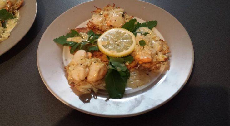 Sea scallops in potato basket with rocket & white wine jus.