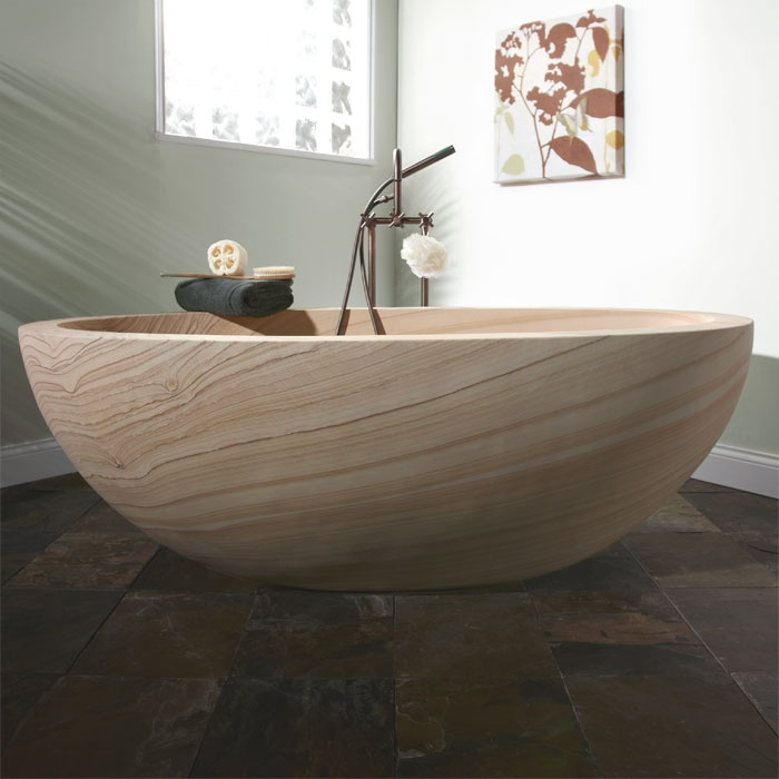 "•Handcrafted from a solid block of sandstone.  • Smooth interior and exterior.  • Overall dimensions: 72"" L x 36-1/2"" W x 23-1/2"" H.  • Tub has no overflow.  installation.  • Tub Weight Uncrated: 1,223 lbs.  • Tub Weight Crated: 1,423 lbs.  Lie back and relax in the beautiful 72"" Ekis Sandstone Tub, crafted from a solid block of sandstone. With waves of sedimentary stone, this tub is a work of art. Add your favorite freestanding tub filler or wall mounted faucet to complete your luxurious…"