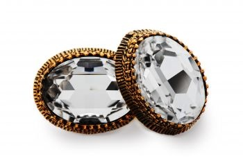 Elegant and striking Swarovski Crystal, white-coloured, in artistic setting of bronze.  http://mysfashion.com