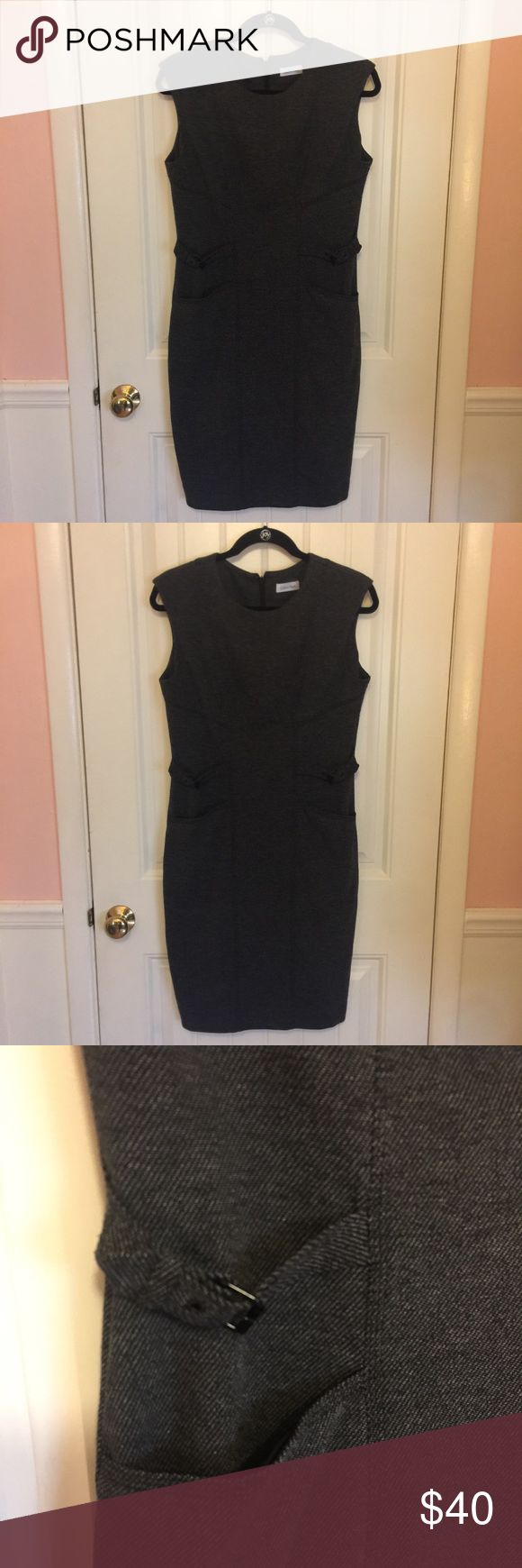 Calvin Klein Gray Tweed Work Shift Dress Calvin Klein gray and black soft tweed knee-length Shift Dress with cap sleeve, pockets, and slimming aide buckle detail. Great condition from a smoke free home. Make me an offer! Calvin Klein Dresses