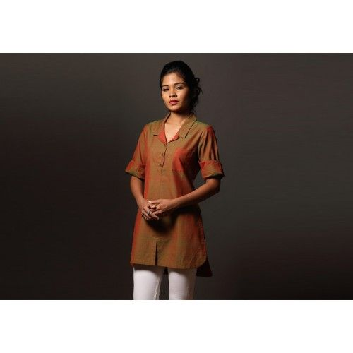 Mylanchi Safari Shirt by Seamstress | PC 16254  A safari shirt in a leaf green-red double shade with a contrast striped pocket. Easy effortless chic, perfect for work or a day about town. Mylanchi ' is malayalam for henna.