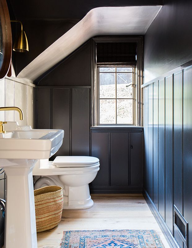 For a young family's attic bathroom, designer Amber Lewis went for a rock 'n' roll feel with with black paint and an eclectic rug. | Photographer: Tessa Neustadt | Designer: Amber Interiors