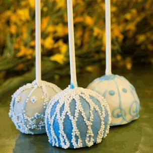 Our delicious brownie pops are decadent wedding favors. Each brownie pop in our modern elegant pearl design is handmade with a brownie center, lovingly coated with delicious chocolate (in white, milk or dark) and then adorned with intricate filigree or vintage scroll patterns in your choice of 8 colors and then topped off with pretty candy pearls.