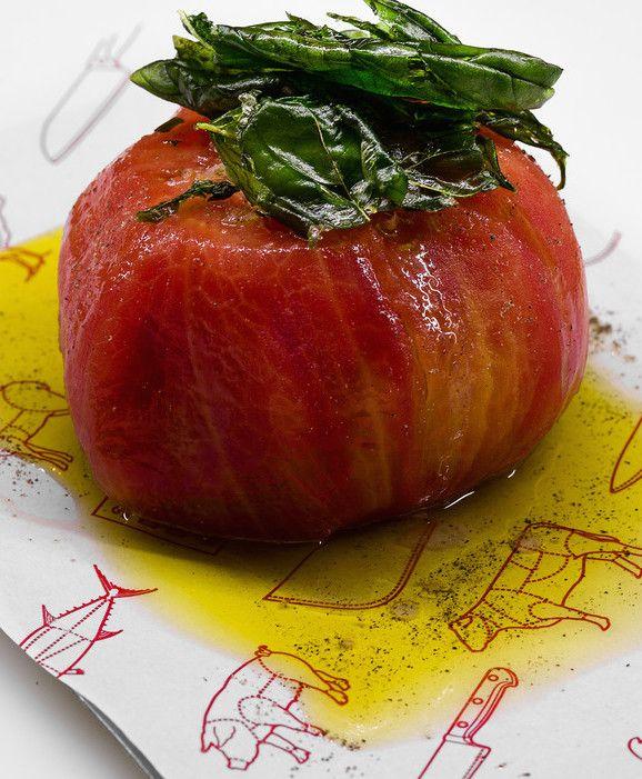 A ripe Navarran tomato with basil is served as simply as a rare steak at the tapas bar Sala de Despiece.