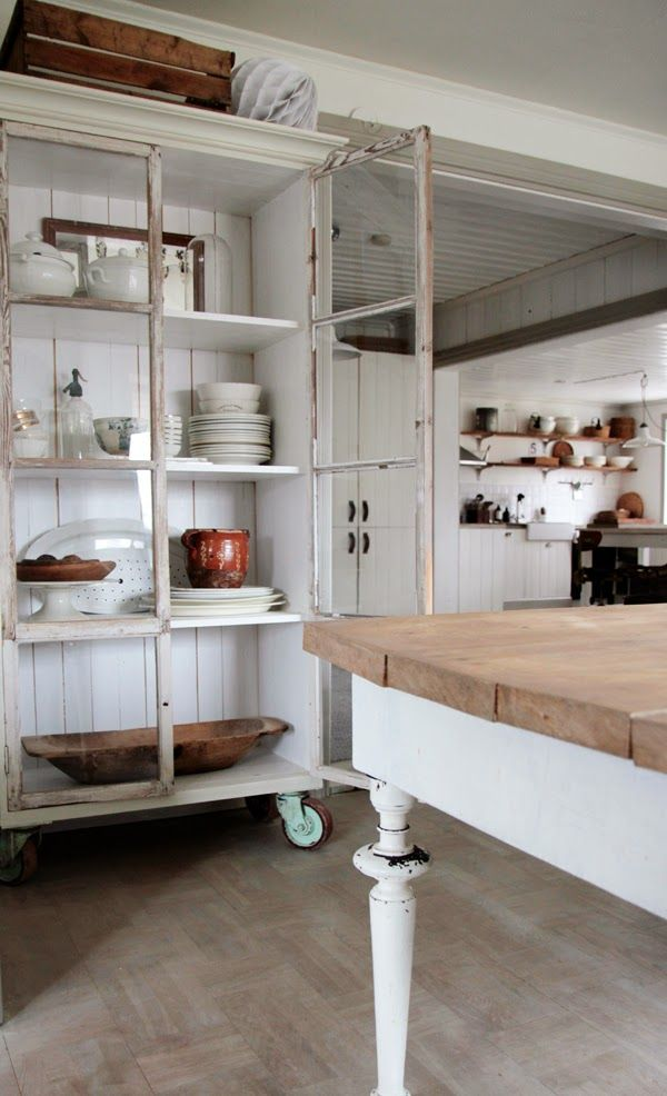 Love the industrial wheels on cabinet. FleaingFrance.....for the love of old