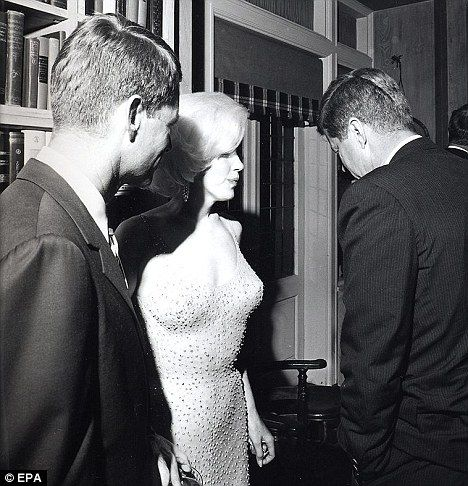 Costly affair: A rare image of Marilyn with President John F. Kennedy (right) and his brother Robert F. Kennedy together after JFKs 19 May 1962 birthday party