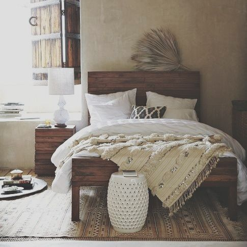 Love the wooden bed frame
