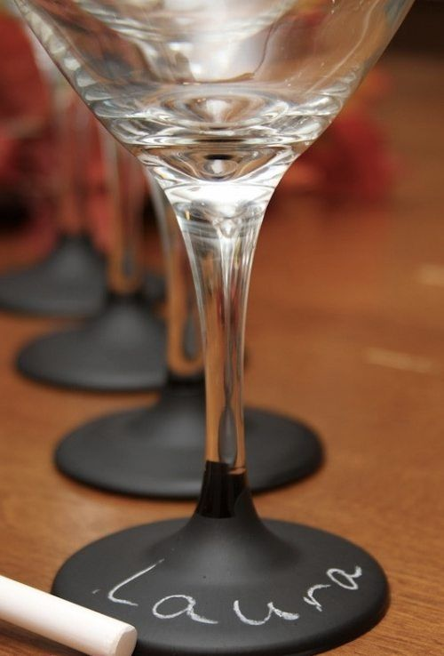 Dip the bottle of wine glasses into chalkboard paint and later use them for labeling! Chalk paint comes in many colours.
