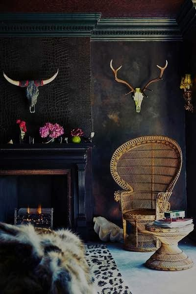 Dark, moody, bohemian interior - Vintage peacock chair - Black bedroom walls
