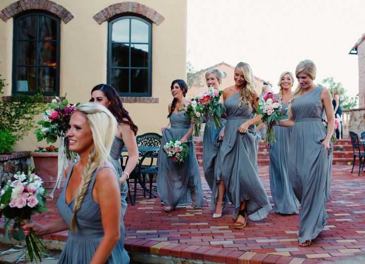 bridesmaids in lovely gray gowns carry their loosely tied and wild bouquets of pink, creams and white roses, dahlias, ranunculus, chocolate cosmos, lisianthus, seeded eucalyptus and lemon leaf.