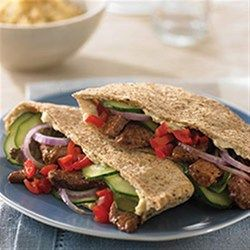 Greek-Style Beef Pita - Stir-fried beef is stuffed into pitas and topped with your family's favorite veggies like cucumbers and olives.
