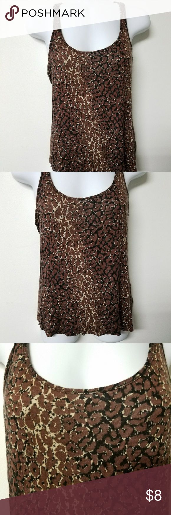 Lily White juniors medium brown leopard tank EUC Up for sale is a Lily White brown and tan leopard tank. It is in excellent used condition and it is a juniors medium. It has a racer back style.   Thanks for looking and please let me know if you have any questions.   Open to offers! 💗 Lily White Tops Tank Tops