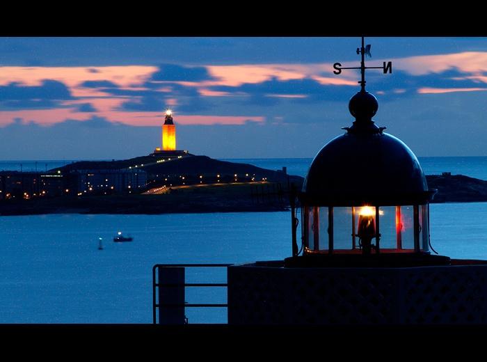 Faro de Mera y al fondo la Torre de Hércules, en A Coruña. Galicia. Spain.