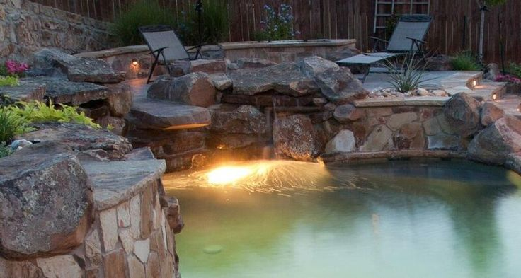 Perfectly positioned lighting in this pool. By Outdoor Signature in Argyle, TX.
