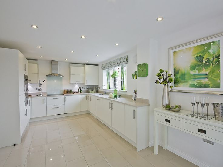 White is the go-to colour for a fresh, light and airy kitchen. Add a burst of green for a little warmth!