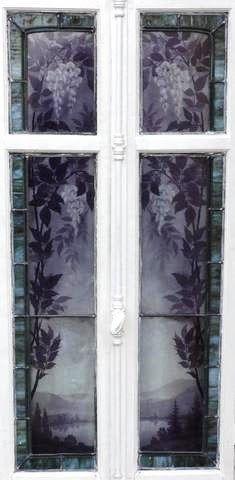 Fenetre à deux battants aux vitraux à décor d'un paysage vosgien entouré de glycines par Gruber (Jacques)