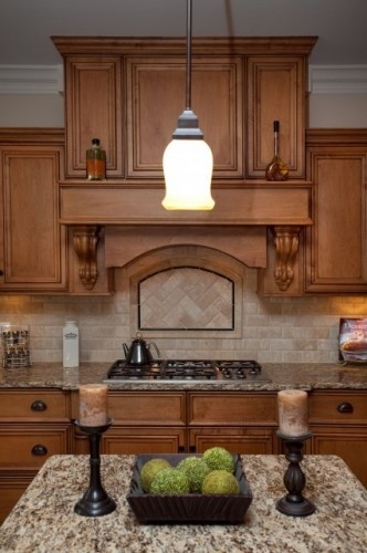 """3""""x6"""" tile on brick pattern. Rope liner surrounding 3""""x6"""" tile set in herringbone pattern inside at the stove's focal point."""