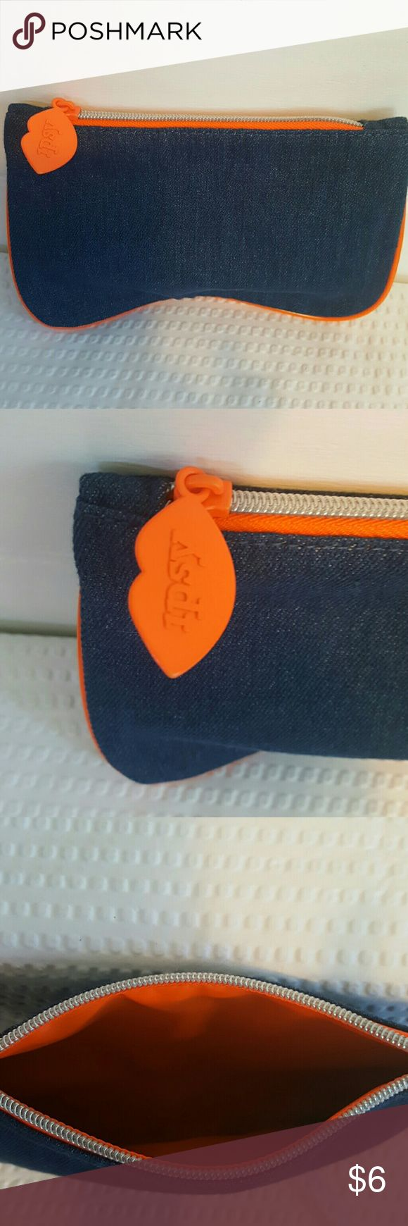 NWOT IPSY make-up/stash bag Indigo blue denim with neon orange piping and silver zipper. Sooo cute! I cannot get enough of these stylish little bags. Slight bean shape at bottom. 5x8 Ipsy Bags Travel Bags