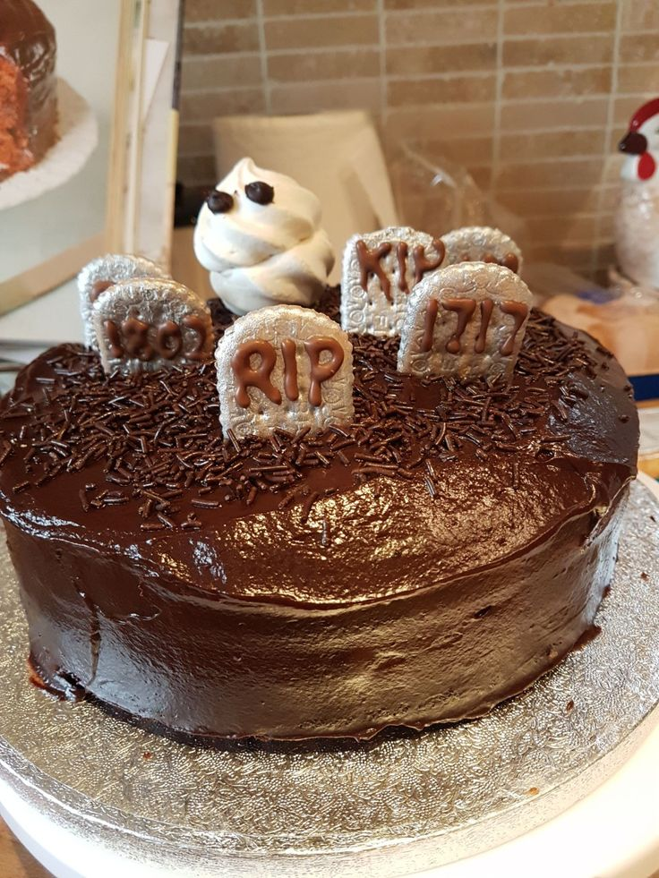 Halloween inspired chocolate cake. Nice biscuits painted grey make good tombstones