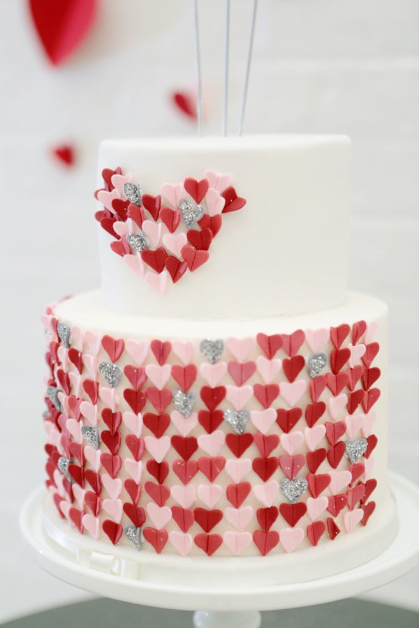 darling wedding cake covered in pink red and silver hearts #weddingcake #cake #weddingchicks http://www.weddingchicks.com/2014/01/28/heart-wedding-cake/