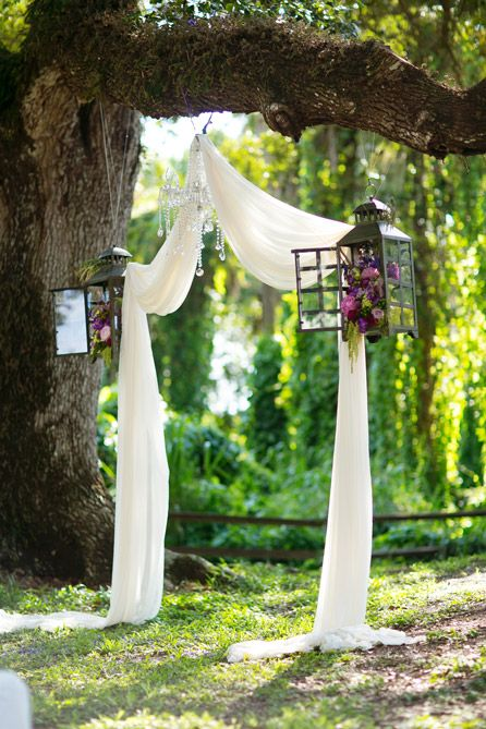 Simple ceremony set up with chandelier and hanging floral lanterns | Photo: Set Free Photography