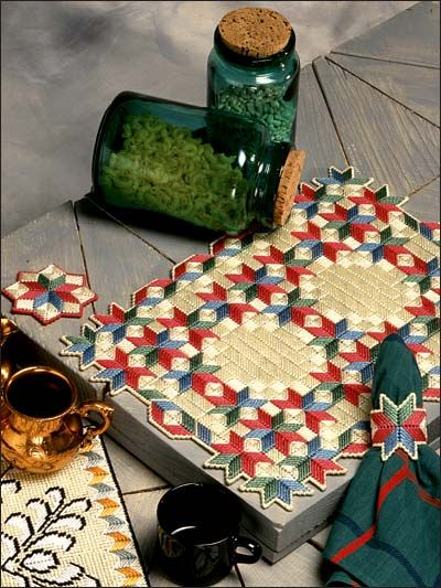 Stars and Cubes: Set includes place mat, coaster and napkin ring, made with 7-mesh plastic canvas and worsted yarn.