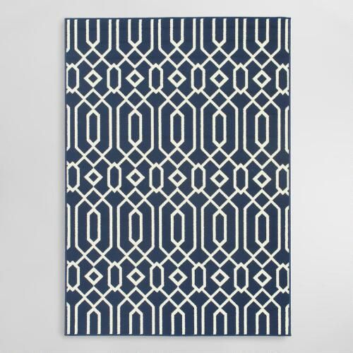 Featuring an intricate geometric design in rich navy blue, our versatile area rug is antimicrobial, stain-resistant and easy to care for, making it perfect for indoor and outdoor spaces.