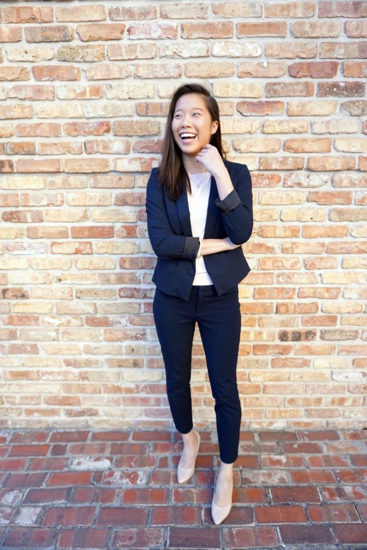 woman wearing navy pant suit with sweater for business formal, skirt the ceiling skirttheceiling.com