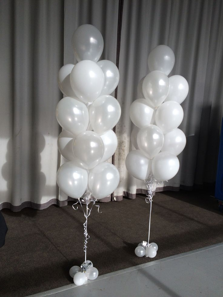 Large 13 balloon arrangements in Pearl (metallic) and Standard (matte) white. Very elegant