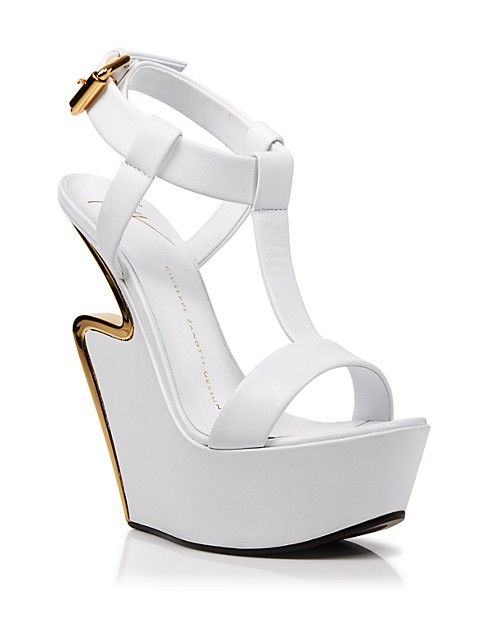 Lightning round: Bold gold-tone accents highlight Giuseppe Zanotti's sculptural, sky-high wedges. | Leather upper, leather lining, leather sole and man made | Made in Italy | Open toe; buckled ankle s