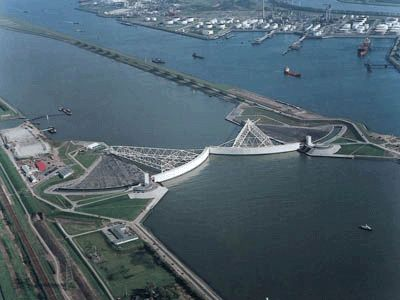 The Maeslant Barrier (The Maaslantkering) is a storm surge barrier in the Nieuwe Waterweg waterway located between the towns of Hoek van Holland and Maassluis, Netherlands, it automatically closes when needed. It is part of the Delta Works and it is one of largest moving structures on Earth.