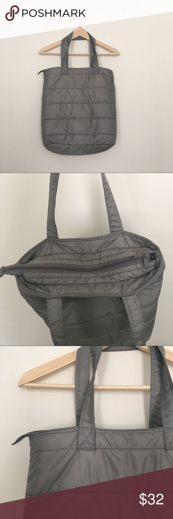 Uniqlo NWOT grey down insulated tote bag Wear your comfy down as a bag in the summer and have an instant pillow wherever you choose to lounge 👍 Uniqlo Bags