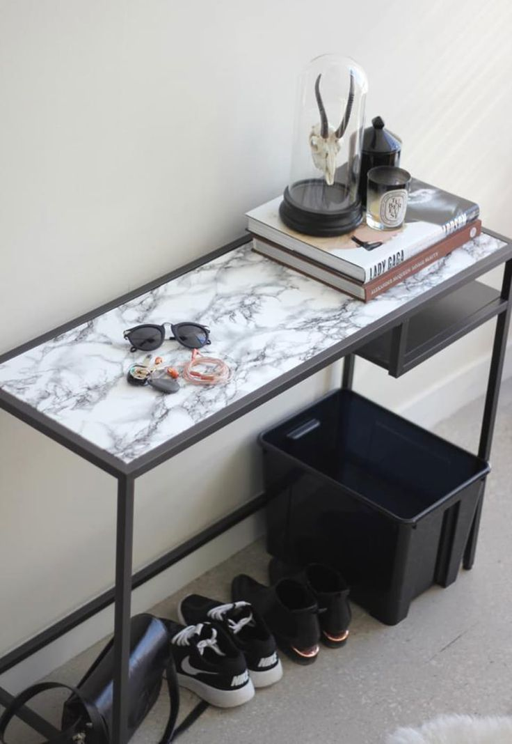 IKEA-deposits table Vittsjö, here transformed into a marble table with contact paper with marble motive.