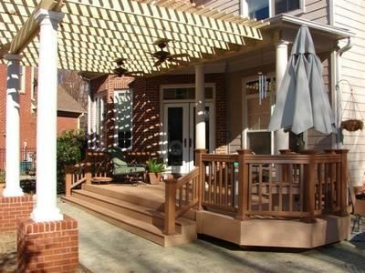 This back porch includes a deck and patio covered with a for Open pergola designs