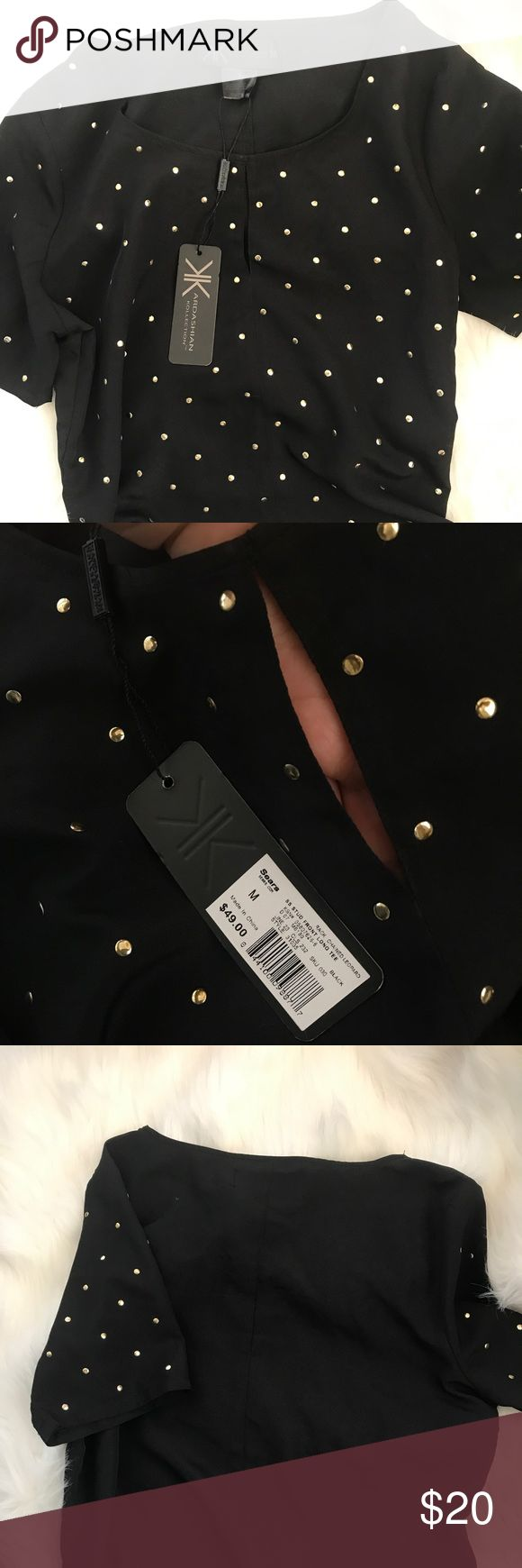 Kardashian Kollection Studded Black Blouse Shirt New with tags! Kardashian kollection studded front Long tee. Flattering shirt beautiful material. It's solid black from the back and it has a peek hole in the front Kardashian Kollection Tops Blouses