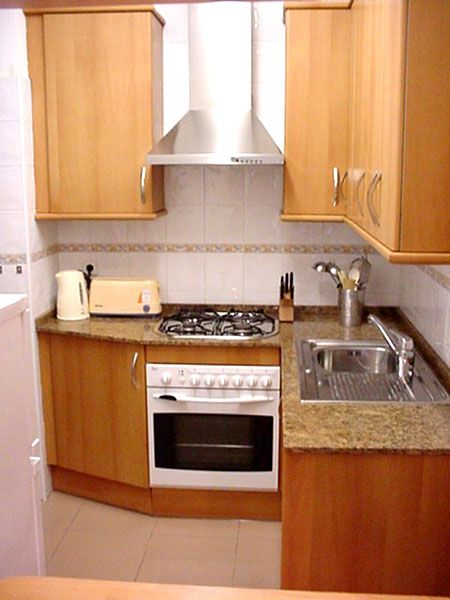 17 best ideas about very small kitchen design on pinterest for Apartment kitchen cabinet ideas