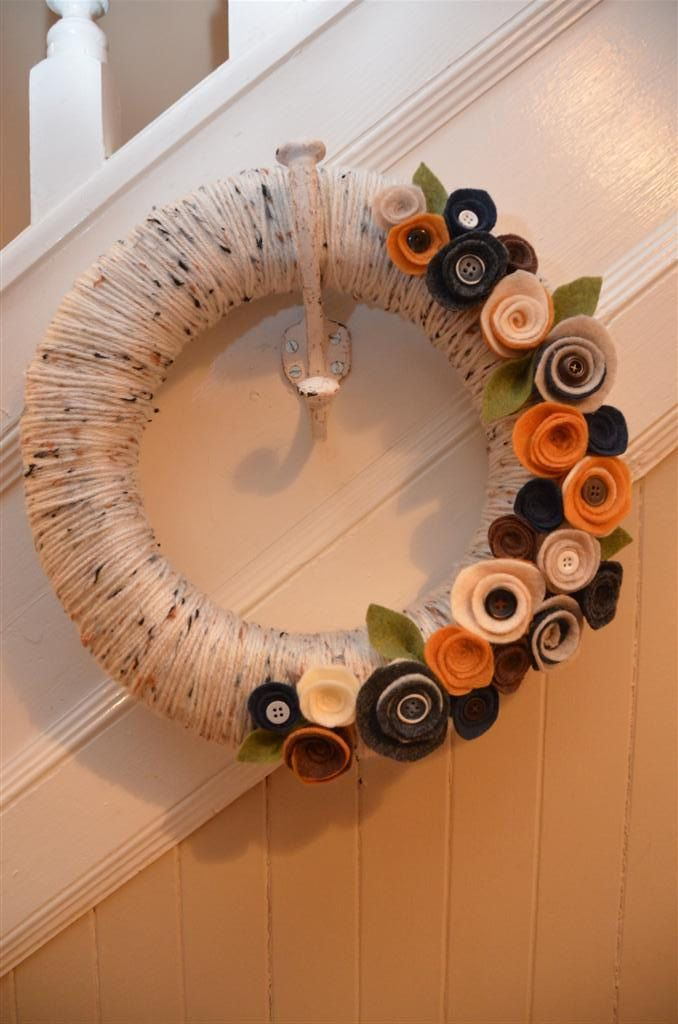 Yarn Wreath - WOODLAND COTTAGE - Yarn Covered Straw Wreath with Felt Flowers and Button Accents - 12 inches. $35.00, via Etsy. *I like the hook on the staircase.