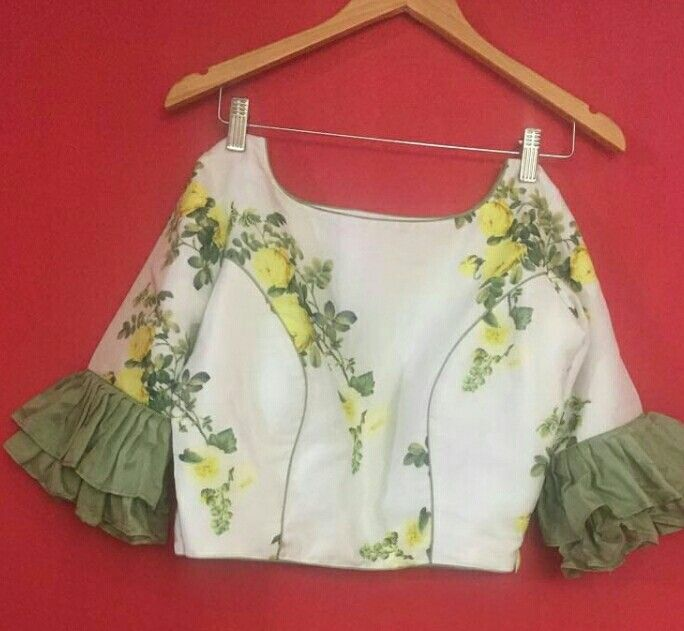 Floral blouse with flared sleeves