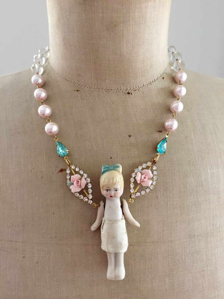 A personal favorite from my Etsy shop https://www.etsy.com/listing/233342765/vintage-bisque-doll-flower-fairy. Antique 1920s or 30s bisque doll statement necklace fairy child toy necklace