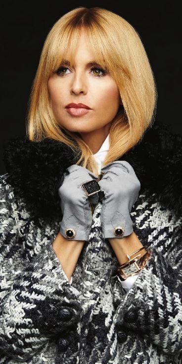 Rachel Zoe: Glovese – Gasper Gloves  Watch and bracelet – Cartier  Cape coat – Rachel Zoe