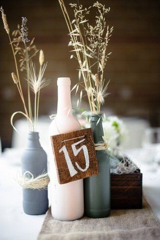 DIY Wedding Table Number Ideas. i like this idea but pain the bottles black and red and have flowers coming from the top and have the numbers painted on