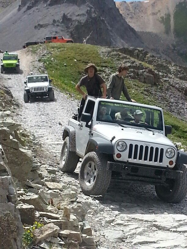 Best Jeep drive! Take Imogene trail up to the top from Ouray Co. At 13, 100 ft you can see the ski town of Telluride.