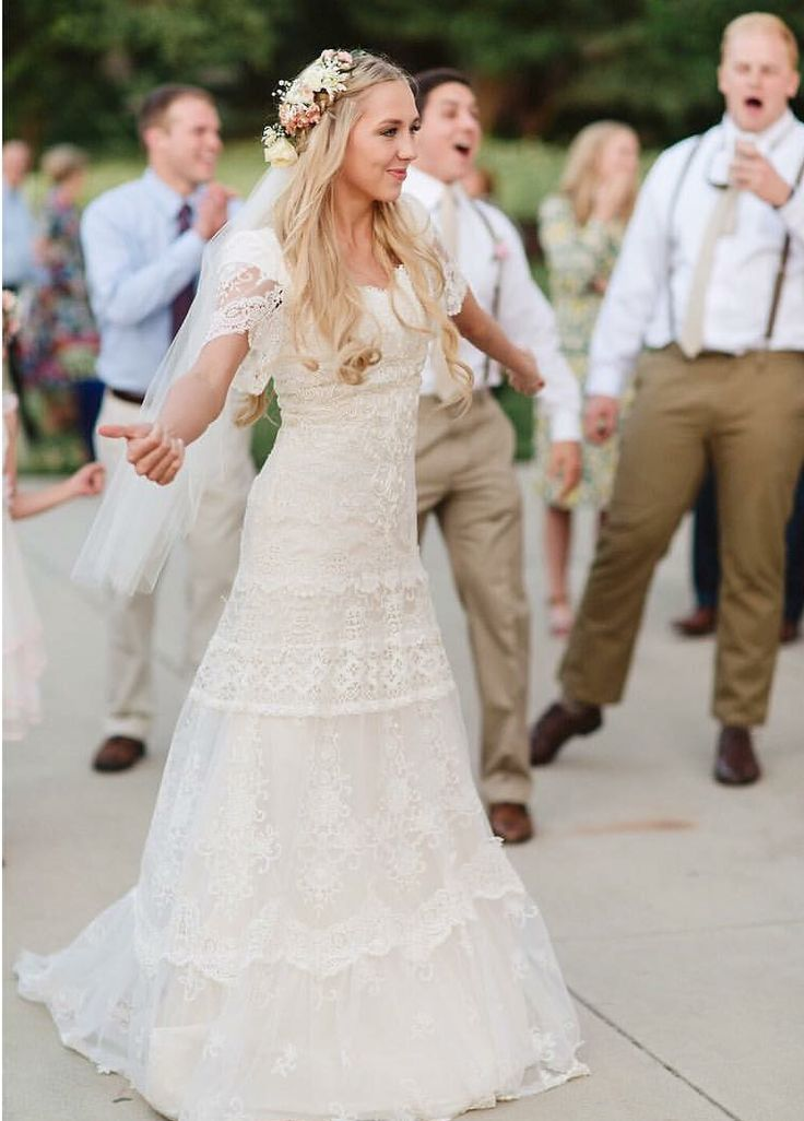 modest wedding dress with lace boho sleeve and a close to the body fit from alta moda. --(modest bridal gown)--