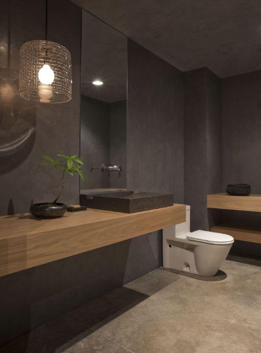 Elegant bathroom in dark tones with an upscale spa-like feel.