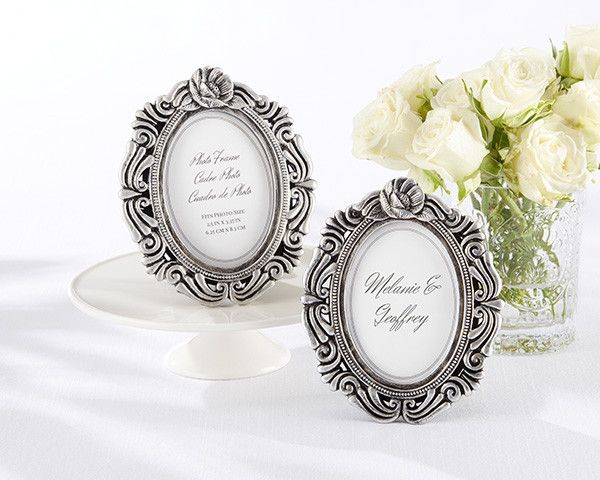 Antiqued Victorian Photo Frame. For couples looking to give a unique wedding favor, ourAntiqued Victorian Photo Frame can be a beautiful and versatile commemorative piece to remind your guests of your special day. Perfect for a garden theme wedding or vintage inspired bridal shower, these vintage-inspired photo frames can be placed at guests tables filled with photos of the happy couple or used as place card holders. Featuring a delicate rose design, these frames can be...