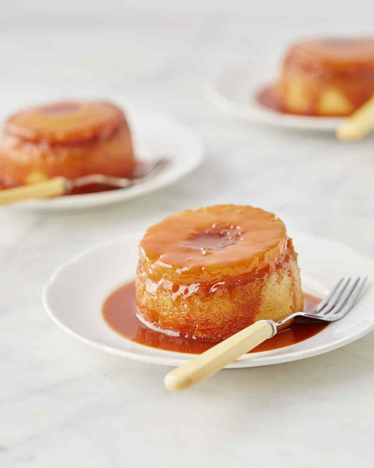"Individual pineapple upside-down cakes sitting in a pool of decadent rum caramel are a guaranteed crowd-pleaser. Martha made this recipe on ""Martha Bakes"" episode 710."