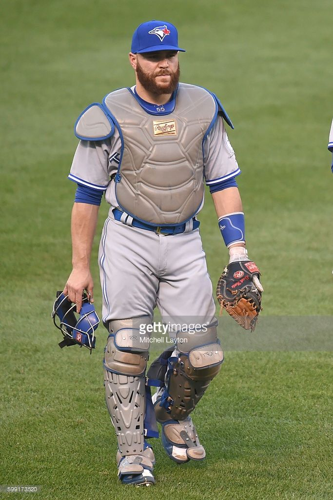 Russell Martin #55 of the Toronto Blue Jays lwalks back to the dug out before a baseball game against the Baltimore Orioles at Oriole Park at Camden Yards on August 31, 2016 in Baltimore, Maryland. The Blue Jays won 5-3.